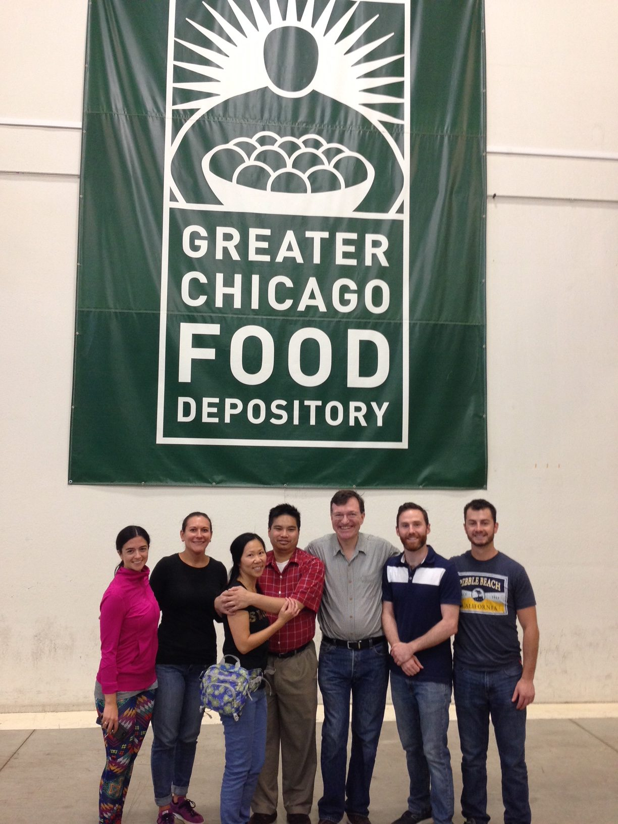 Members of the Young Lawyers Group and other members of the Guild help package thousands of pounds worth of sweet potatoes at the Greater Chicago Food Depository.